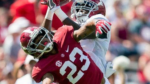 FILE - In this April 22, 2017, file photo, Alabama wide receiver Jerry Jeudy (4) makes a fingertip catch over Alabama defensive back Aaron Robinson (23) for a touchdown during the first half of Alabama's annual spring NCAA college football game at Bryant-Denny Stadium in Tuscaloosa, Ala. Plenty of players showed this spring they're capable of replacing those departed stars and making names for themselves this fall. Jeudy  caught five passes for 134 yards in the spring game with touchdown catches of 25 and 29 yards. (Vasha Hunt/AL.com via AP, File)