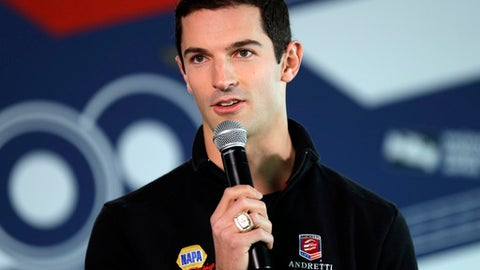 Indianapolis 500 champion Alexander Rossi answers questions after he received his Indy 500 winner's ring for winning last years race at the Indianapolis Motor Speedway in Indianapolis, Wednesday, May 3, 2017. (AP Photo/Michael Conroy)