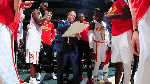 ATLANTA, GA - APRIL 24:  Head Coach Mike Budenholzer of the Atlanta Hawks goes over a play during Game Four of the Eastern Conference Quarterfinals of the 2017 NBA Playoffs on April 24, 2017 at Philips Arena in Atlanta, Georgia. NOTE TO USER: User expressly acknowledges and agrees that, by downloading and/or using this photograph, user is consenting to the terms and conditions of the Getty Images License Agreement. Mandatory Copyright Notice: Copyright 2017 NBAE (Photo by Scott Cunningham/NBAE via Getty Images)
