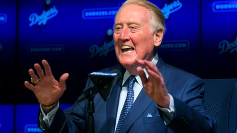 Hall of Fame broadcaster Vin Scully speaks to reporters about being inducted into the Los Angeles Dodgers Ring of Honor, prior to a baseball game between the Dodgers and the San Francisco Giants, Wednesday, May 3, 2017, in Los Angeles. (AP Photo/Mark J. Terrill)