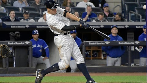 New York Yankees' Aaron Judge hits a two-run home run during the third inning of the team's baseball game against the Toronto Blue Jays on Wednesday, May 3, 2017, at Yankee Stadium in New York. (AP Photo/Bill Kostroun)