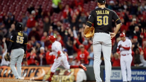 Pittsburgh Pirates starting pitcher Jameson Taillon (50) watches as Cincinnati Reds' Billy Hamilton, center left, runs the bases on a three-run home run during the fourth inning of a baseball game, Wednesday, May 3, 2017, in Cincinnati. (AP Photo/John Minchillo)