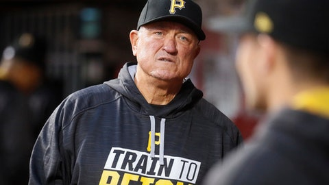 Pittsburgh Pirates manager Clint Hurdle stands in the dugout during the fourth inning of the team's baseball game against the Cincinnati Reds, Wednesday, May 3, 2017, in Cincinnati. (AP Photo/John Minchillo)