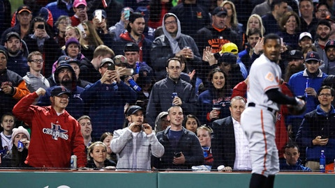 Boston Red Sox fans taunt and take pictures of Baltimore Orioles' Adam Jones after he was ejected for arguing a strikeout call during the fifth inning of a baseball game at Fenway Park in Boston, Wednesday, May 3, 2017. (AP Photo/Charles Krupa)