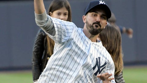 New York City FC soccer player David Villa throws out the first pitch before a baseball game between the New York Yankees and Toronto Blue Jays Wednesday, May 3, 2017, at Yankee Stadium in New York. (AP Photo/Bill Kostroun)