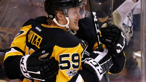 Pittsburgh Penguins' Jake Guentzel (59) celebrates his goal during the second period of Game 4 in an NHL Stanley Cup Eastern Conference semifinal hockey game against the Washington Capitals in Pittsburgh, Wednesday, May 3, 2017. (AP Photo/Gene J. Puskar)