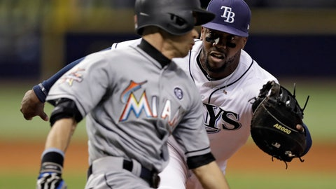 Tampa Bay Rays first baseman Rickie Weeks Jr., background, tags out Miami Marlins' Ichiro Suzuki, of Japan, at first during the seventh inning of a baseball game, Wednesday, May 3, 2017, in St. Petersburg, Fla. (AP Photo/Chris O'Meara)