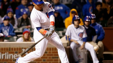 Chicago Cubs' Willson Contreras hits a pinch-hit double off Philadelphia Phillies starting pitcher Jerad Eickhoff, scoring Jason Heyward, and Ben Zobrist, during the sixth inning of a baseball game Wednesday, May 3, 2017, in Chicago. (AP Photo/Charles Rex Arbogast)