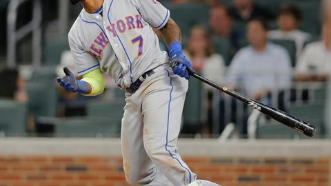 New York Mets third baseman Jose Reyes (7) follows through on a three-run double in the eighth inning of a baseball game against the Atlanta Braves, Wednesday, May 3, 2017, in Atlanta. (AP Photo/John Bazemore)