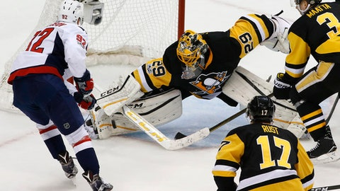 Pittsburgh Penguins goalie Marc-Andre Fleury (29) stops a shot by Washington Capitals' Evgeny Kuznetsov (92) during the first period of Game 4 in an NHL hockey Stanley Cup Eastern Conference semifinal in Pittsburgh, Wednesday, May 3, 2017. The Penguins won 3-2. (AP Photo/Gene J. Puskar)