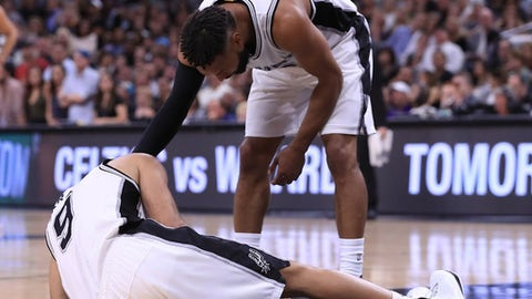 SAN ANTONIO, TX - MAY 03:  Patty Mills #8 of the San Antonio Spurs checks on Tony Parker #9 as he lay on the floor after an injury against the Houston Rockets during Game Two of the NBA Western Conference Semi-Finals at AT&T Center on May 3, 2017 in San Antonio, Texas.  NOTE TO USER: User expressly acknowledges and agrees that, by downloading and or using this photograph, User is consenting to the terms and conditions of the Getty Images License Agreement.  (Photo by Ronald Martinez/Getty Images)