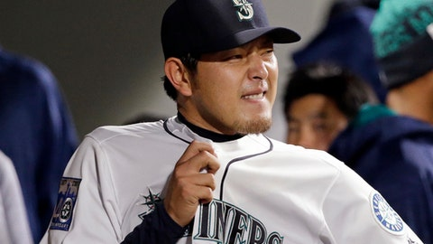 Seattle Mariners starting pitcher Hisashi Iwakuma looks out from the dugout after being removed during the sixth inning of the team's baseball game against the Los Angeles Angels, Wednesday, May 3, 2017, in Seattle. (AP Photo/Elaine Thompson)