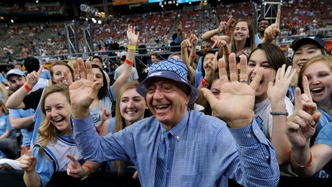 """FILE - In this April 3, 2017, file photo, ESPN's Dick Vitale stands with North Carolina fans before the team's championship game against Gonzaga in the NCAA men's college basketball tournament in Glendale, Ariz. Vitale says he has turned his life """"24-7"""" into raising money for pediatric cancer research. """"I will do this is until my last breath,"""" he said Wednesday, May 3. """"One of the reasons I'm upset is that just four cents of every dollar raised to fight cancer goes to pediatric cancer research and that shouldn't be happening."""" (AP Photo/David J. Phillip, File)"""