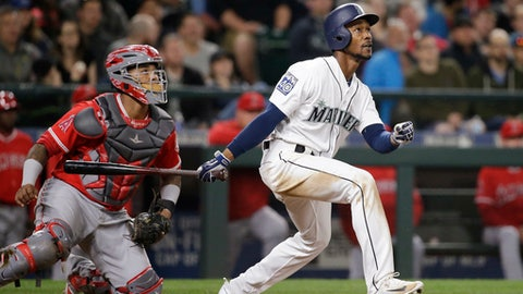 Seattle Mariners' Jarrod Dyson, right, and Los Angeles Angels catcher Martin Maldonado watch the path of Dyson's two-run double during the eighth inning of a baseball game Wednesday, May 3, 2017, in Seattle. The Mariners won 8-7. (AP Photo/Elaine Thompson)