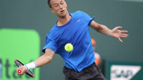 Philipp Kohlschreiber, of Germany, starts to hit a forehand to Rafael Nadal, of Spain, during the Miami Open tennis tournament, Sunday, March 26, 2017, in Key Biscayne, Fla. Nadal won 0-6, 6-2, 6-3. (AP Photo/Luis M. Alvarez)