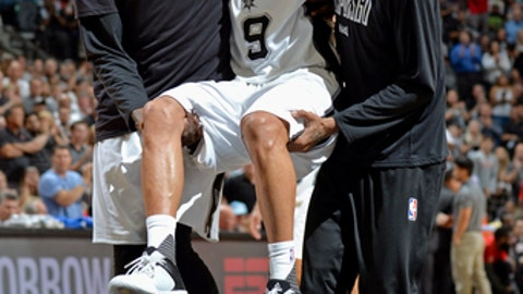 SAN ANTONIO, TX - MAY 3:  Dejounte Murray #5 and Dewayne Dedmon #3 carry Tony Parker #9 of the San Antonio Spurs off the court after sustaining a knee injury during Game Two of the Eastern Conference Semifinals against the Houston Rockets during the 2017 NBA Playoffs on MAY 3, 2017 at the AT&T Center in San Antonio, Texas. NOTE TO USER: User expressly acknowledges and agrees that, by downloading and or using this photograph, user is consenting to the terms and conditions of the Getty Images License Agreement. Mandatory Copyright Notice: Copyright 2017 NBAE (Photos by Mark Sobhani/NBAE via Getty Images)