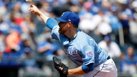 Kansas City Royals pitcher Ian Kennedy throws to a batter in the first inning of a baseball game against the Chicago White Sox at Kauffman Stadium in Kansas City, Mo., Thursday, May 4, 2017. (AP Photo/Colin E. Braley)
