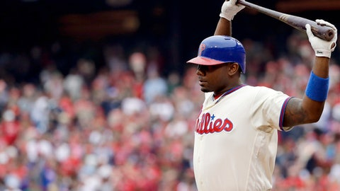 """FILE - In this Oct. 2, 2016, file photo, Philadelphia Phillies' Ryan Howard prepares to bat during a baseball game against the New York Mets in Philadelphia. Howard is an MVP, a World Series champion and once one of baseball's most feared sluggers. So what's he doing in the minor leagues at age 37? """"I've still got something in the tank,"""" he says.  (AP Photo/Matt Slocum, File)"""