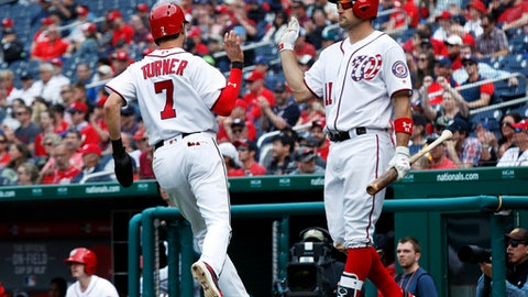 Washington Nationals Trea Turner (7) is congratulated by teammate Ryan Zimmerman (11) after scoring during the eighth inning of a baseball game against the Arizona Diamondbacks in Washington, Thursday, May 4, 2017. The Nationals won 4-2. (AP Photo/Manuel Balce Ceneta)