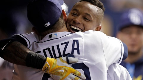 Tampa Bay Rays' Tim Beckham, right, hugs Steven Souza Jr. after Beckham hit a two-run home run off Miami Marlins' Dan Straily during the fourth inning of a baseball game Thursday, May 4, 2017, in St. Petersburg, Fla. (AP Photo/Chris O'Meara)