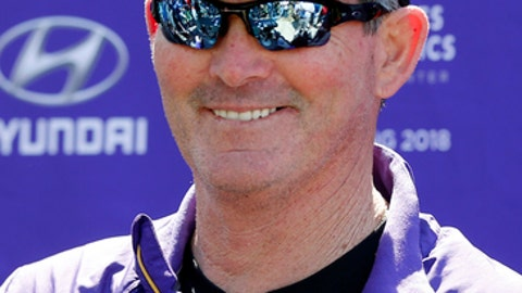 Minnesota Vikings head coach Mike Zimmer smiles in response to a question during the NFL football team's rookies minicamp Friday, May 5, 2017, in Eden Prairie, Minn. (AP Photo/Jim Mone)