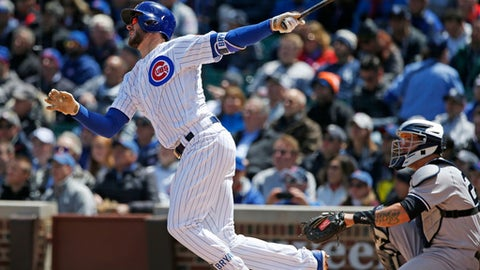 Chicago Cubs' Kris Bryant follows through on a solo home run during the first inning of an interleague baseball game against the New York Yankees, Friday, May 5, 2017 in Chicago. (AP Photo/Nam Y. Huh)