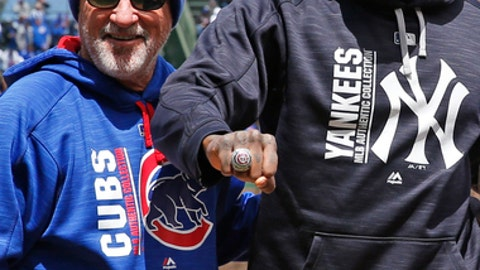 New York Yankees relief pitcher Aroldis Chapman, right, stands with Chicago Cubs manager Joe Maddon as Chapman received his 2016 World Series ring before a baseball game between the New York Yankees and the Chicago Cubs at Wrigley Field, Friday, May 5, 2017 in Chicago. (AP Photo/Nam Y. Huh)