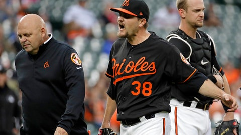 Baltimore Orioles starting pitcher Wade Miley (38) reacts as he walks off the field after being relieved after he was hit by Chicago White Sox's Avisail Garcia's single in the first inning of a baseball game in Baltimore, Friday, May 5, 2017. (AP Photo/Patrick Semansky)