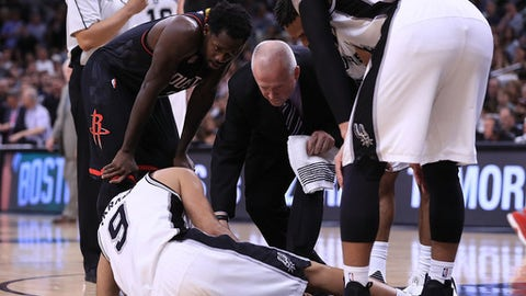 SAN ANTONIO, TX - MAY 03:  Tony Parker #9 of the San Antonio Spurs lays on the floor after an injury against the Houston Rockets during Game Two of the NBA Western Conference Semi-Finals at AT&T Center on May 3, 2017 in San Antonio, Texas.  NOTE TO USER: User expressly acknowledges and agrees that, by downloading and or using this photograph, User is consenting to the terms and conditions of the Getty Images License Agreement.  (Photo by Ronald Martinez/Getty Images)