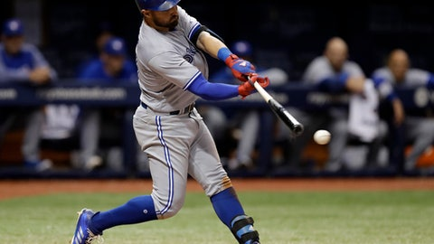 Toronto Blue Jays' Kevin Pillar connects for an RBI-double off Tampa Bay Rays relief pitcher Jumbo Diaz during the eighth inning of a baseball game Friday, May 5, 2017, in St. Petersburg, Fla. Blue Jays' Devon Travis scored. (AP Photo/Chris O'Meara)