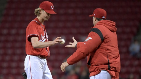 Cincinnati Reds pitcher Bronson Arroyo, left, hands the ball to manager Bryan Price in the sixth inning of a baseball game against the San Francisco Giants, Friday, May 5, 2017, in Cincinnati. (AP Photo/Michael E. Keating)
