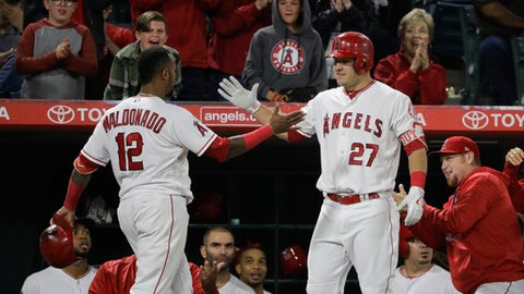 Los Angeles Angels' Martin Maldonado, left, celebrates his home run with Mike Trout during the sixth inning of a baseball game against the Houston Astros, Friday, May 5, 2017, in Anaheim, Calif. (AP Photo/Jae C. Hong)