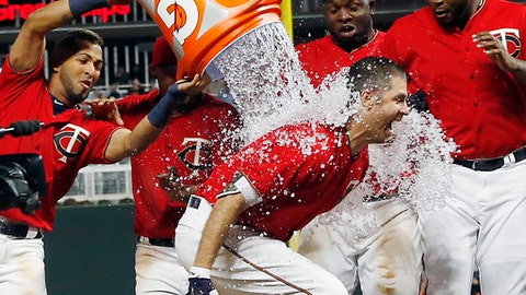 Minnesota Twins' Joe Mauer gets doused with water after his walk-off solo home run in the ninth inning off Boston Red Sox relief pitcher Matt Barnes in a baseball game Friday, May 5, 2017, in Minneapolis. The Twins won 4-3. (AP Photo/Jim Mone)