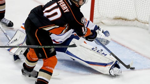Anaheim Ducks right wing Corey Perry scores the game winning goal past Edmonton Oilers goalie Cam Talbot during the fifth period in overtime in Game 5 of a second-round NHL hockey Stanley Cup playoff series in Anaheim, Calif., Friday, May 5, 2017. (AP Photo/Chris Carlson)