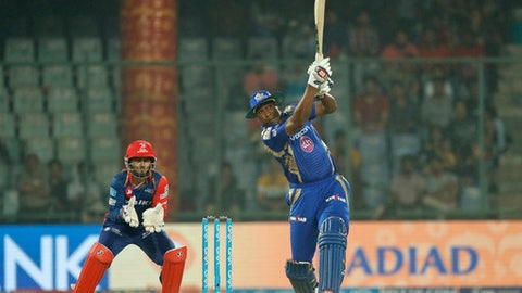 Mumbai Indians' Kieron Pollard, right, plays a shot during the Indian Premier League (IPL) cricket match against Delhi Daredevils in New Delhi, India, Saturday, May 6, 2017. (AP Photo/Tsering Topgyal)