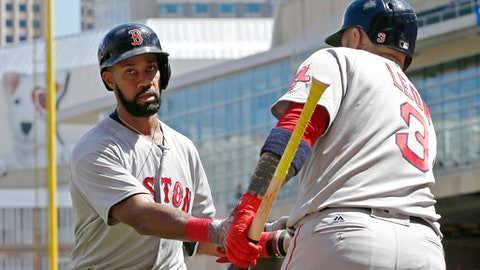 Boston Red Sox's Chris Young, left, is congratulated by Sandy Leon after hitting a home run off Minnesota Twins pitcher Drew Rucinski in the fifth inning of a baseball game Saturday, May 6, 2017, in Minneapolis. Young also homered in the second inning. (AP Photo/Jim Mone)