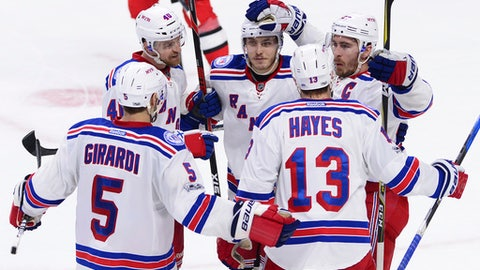 New York Rangers defenseman Ryan McDonagh (27) celebrates his goal with defenseman Dan Girardi (5) right wing Kevin Hayes (13) right wing Michael Grabner (40) and right wing Jesper Fast (19) during the second period against the Ottawa Senators in Game 5 in the second-round of the NHL hockey Stanley Cup playoffs in Ottawa on Saturday, May 6, 2017. (Sean Kilpatrick/The Canadian Press via AP)