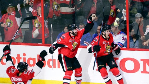 Ottawa Senators' Kyle Turris (7) celebrates after he scored the game-winning goal during overtime against the New York Rangers in Game 5 in the second round of the NHL hockey Stanley Cup playoffs in Ottawa on Saturday, May 6, 2017. The Senators won 5-4 in overtime.(Sean Kilpatrick/The Canadian Press via AP)