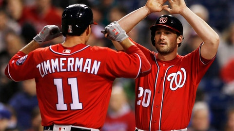 Washington Nationals Ryan Zimmerman (11) is cheered by Daniel Murphy (20) at home plate after he hit a two run home run off Philadelphia Phillies starting pitcher Vince Velasquez (28) in the fourth inning of a baseball game, Saturday, May 6, 2017, in Philadelphia. (AP Photo/Laurence Kesterson)