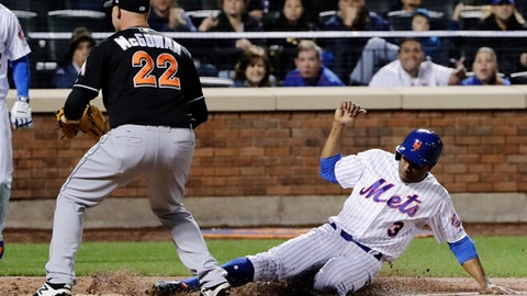 New York Mets' Curtis Granderson (3) slides past Miami Marlins relief pitcher Dustin McGowan (22) to score on a passed ball during the fifth inning of a baseball game, Saturday, May 6, 2017, in New York. (AP Photo/Frank Franklin II)