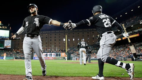 Chicago White Sox's Yolmer Sanchez, left, high-fives teammate Leury Garcia after scoring on a single by Leury Garcia in the fifth inning of a baseball game against the Baltimore Orioles in Baltimore, Saturday, May 6, 2017. (AP Photo/Patrick Semansky)