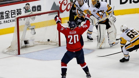 Washington Capitals center Lars Eller (20), from Denmark, celebrates as teammate Alex Ovechkin (8), from Russia, scores a goal as Pittsburgh Penguins goalie Marc-Andre Fleury (29) and teammates Olli Maatta (3), from Finland, Ron Hainsey (65), watch the puck go into the net during the third period of Game 5 in the second-round of the NHL hockey Stanley Cup playoffs, Saturday, May 6, 2017, in Washington. The Capitals won 4-2. (AP Photo/Carolyn Kaster)