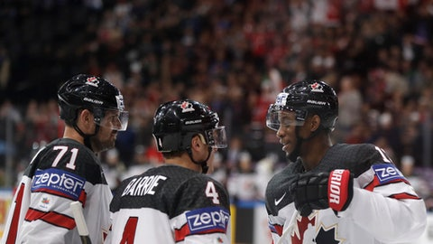 Canada's Tyson Barrie, center, celebrates with teammates Wayne Simmonds, right, and Alex Killorn, left, scoring his sides first goal during the Ice Hockey World Championships group B match between France and Norway in the AccorHotels Arena in Paris, France, Sunday, May 7, 2017. (AP Photo/Petr David Josek)