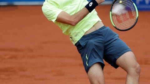 Guido Pella of Argentina returns the ball to Alexander Zverev of Germany during the men's final match at the ATP tennis tournament in Munich, Germany, Sunday, May 7, 2017. (AP Photo/Matthias Schrader)
