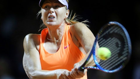 FILE - A Wednesday, April 26, 2017 file photo showing Russia's Maria Sharapova hitting a backhand against Italy's Roberta Vinci at the Porsche Tennis Grand Prix in Stuttgart, Germany.  Maria Sharapova recovered from a shaky opening to defeat Mirjana Lucic-Baroni of Croatia 4-6, 6-4, 6-0 in the first round of the Madrid Open on Sunday, May 7, 2017, setting up a match against Eugenie Bouchard, one of the most outspoken players against her return from doping. (AP Photo/Michael Probst, File)