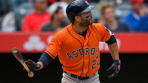 Houston Astros' Jose Altuve hits a three-run home run during the third inning of a baseball game against the Los Angeles Angels, Sunday, May 7, 2017, in Anaheim, Calif. (AP Photo/Mark J. Terrill)