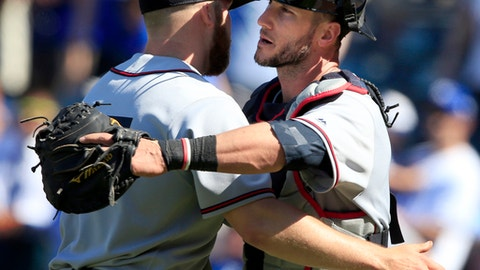 Cleveland Indians catcher Yan Gomes, right, congratulates relief pitcher Cody Allen, left, following a baseball game against the Kansas City Royals at Kauffman Stadium in Kansas City, Mo., Sunday, May 7, 2017. The Indians defeated the Royals 1-0. (AP Photo/Orlin Wagner)