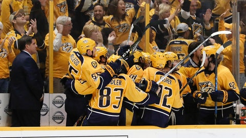 Nashville Predators players celebrate after Calle Jarnkrok, not shown, scored an empty-net goal against the St. Louis Blues during the third period in Game 6 of a second-round NHL hockey playoff series Sunday, May 7, 2017, in Nashville, Tenn. At left is Predators head coach Peter Laviolette. The Predators won 3-1 to win the series 4-2. (AP Photo/Mark Humphrey)