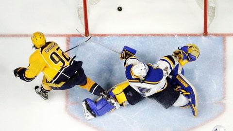 Nashville Predators center Ryan Johansen (92) scores the winning goal against St. Louis Blues goalie Jake Allen (34) during the third period in Game 6 of a second-round NHL hockey playoff series, Sunday, May 7, 2017, in Nashville, Tenn. The Predators won 3-1 to win the series 4-2. (AP Photo/Mark Humphrey)