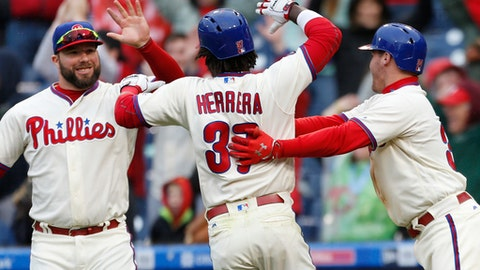 Philadelphia Phillies' Cameron Rupp, left, and Andrew Knapp, right, cheer Odubel Herrera (37) after Herrera scored on a winning sacrifice fly by Freddy Galvis in the 10th inning of a baseball game against the Washington Nationals, Sunday, May 7, 2017, in Philadelphia. (AP Photo/Laurence Kesterson)